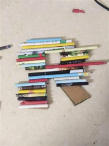 Glue or hot glue paper rolls on to design